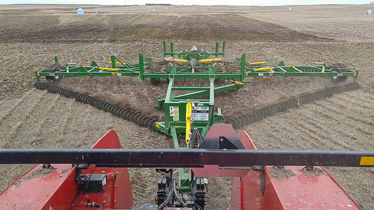 Close-up view of a Kelly Chain cultivating the alfalfa field